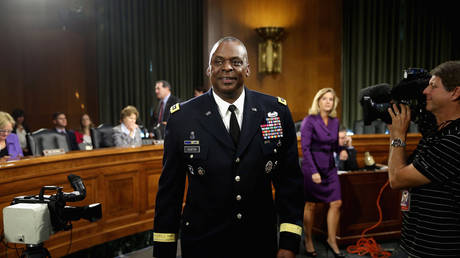 FILE PHOTO: Gen. Lloyd Austin III prepares to testify before the Senate Armed Services Committee during a hearing in the Dirksen Senate Office Building on Capitol Hill September 16, 2015 in Washington, DC
