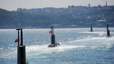 FILE PHOTO: Turkish submarines line up during a military parade marking the 87th anniversary of Victory Day in Istanbul on August 30, 2009
