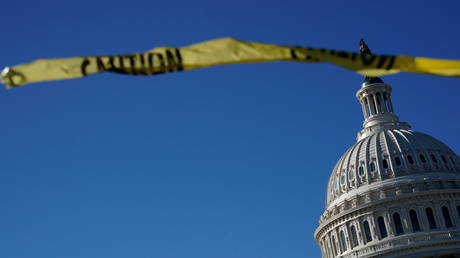 The US Capitol is shown with caution tape in the foreground.