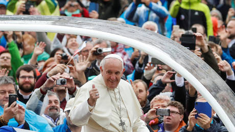 FILE PHOTO: Pope Francis gestures as he arrives for the weekly general audience at the Vatican, November 13, 2019