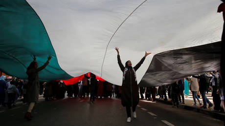 FILE PHOTO: Demonstrators take part in a protest against the U.S. President Donald Trump's Mideast peace plan, in Rabat, Morocco, February 9, 2020