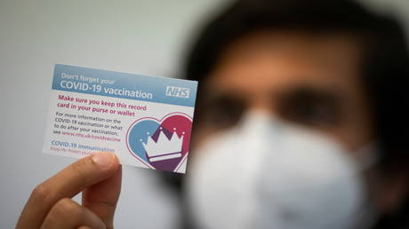 A Covid-19 vaccination reminder card at the Hurley Clinic in London, Britain December 14, 2020.