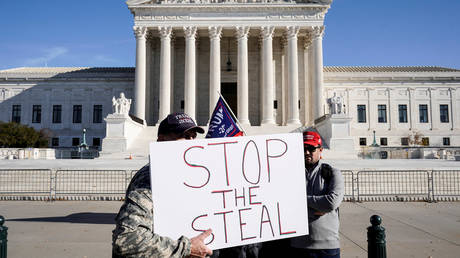 FILE PHOTO: Supporters of U.S. President Donald Trump stand in front of the Supreme Court as the court reviews a lawsuit filed by Texas seeking to undo President-elect Joe Biden's election victory in Washington, U.S., December 11, 2020