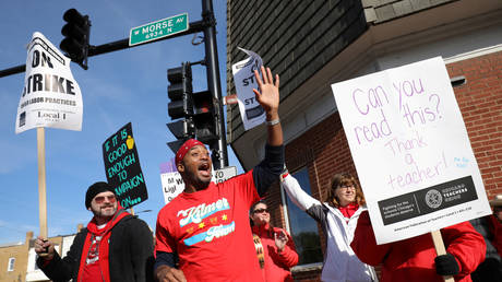 Chicago teachers are shown during a strike last year that shut down schools for 11 days and led to higher pay and other concessions. This time around, many teachers plan to stay home when schools reopen in January because of Covid-19 fears.
