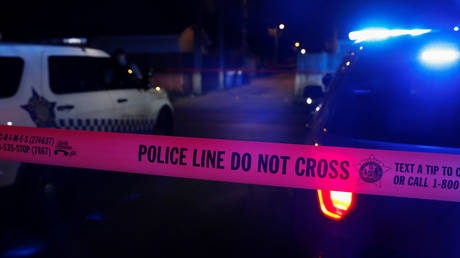 FILE PHOTO: Chicago police tape marks a crime scene in the South Side of Chicago, Illinois.