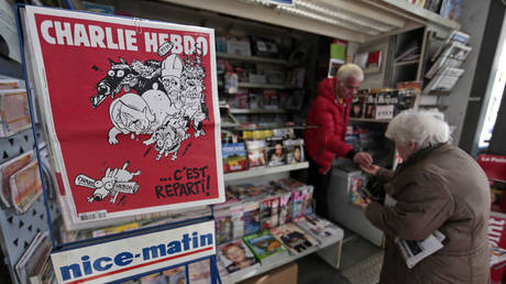 FILE PHOTO The front page of the new issue of satirical French weekly Charlie Hebdo entitled is displayed at a kiosk in Nice © REUTERS/Eric Gaillard