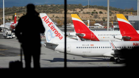Iberia and Air Europa airplanes are parked at a tarmack at Adolfo Suarez Barajas airport in Madrid, Spain, December 15, 2020.