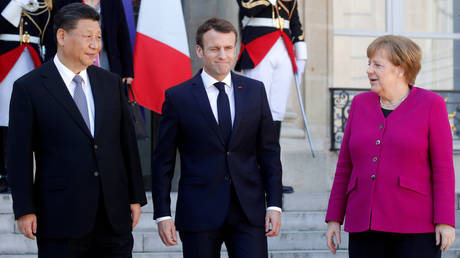FILE PHOTO: French President Emmanuel Macron, German Chancellor Angela Merkel and Chinese President Xi Jinping leave following a meeting at the Elysee Palace in Paris, France, March 26, 2019