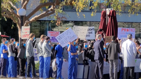 Healthcare workers protest Stanford University's vaccine rollout at the Stanford Medical Center in Palo Alto, California, December 18, 2020.