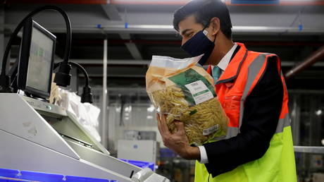 UK Chancellor Rishi Sunak caught on his own wee spending spree during a visit to a tesco.com distribution centre in London on November 11, 2020.