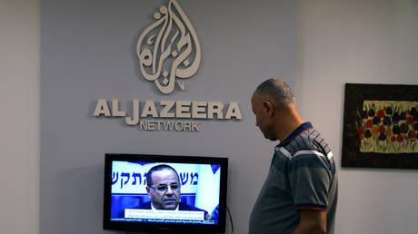 FILE PHOTO: An employee working inside the office of Qatar-based Al-Jazeera network in Jerusalem August 7, 2017. © REUTERS/Ammar Awad