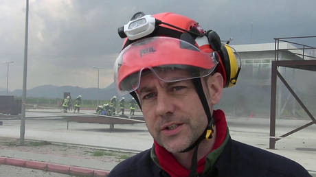 FILE PHOTO: Founder and director of Mayday Rescue, talks to the media during training exercises in southern Turkey, March 19, 2015.