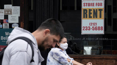 People walk past a shuttered store following the outbreak of coronavirus disease in New York City, October 1, 2020.
