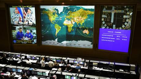 Employees of the mission control Center during the operation for launching into orbit, rendezvous and docking of the Soyuz MS-04 spacecraft with the ISS.