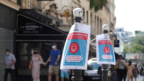 FILE PHOTO: Pedestrians walk amid the spread of Covid-19 in Paris, France.