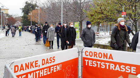 FILE PHOTO. People queue before a mass testing on the coronavirus disease  in Vienna, Austria.