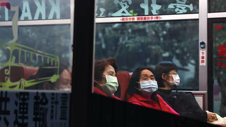 People sit in a bus while wearing protective masks in Taipei, Taiwan, December 22, 2020. © REUTERS/Ann Wang