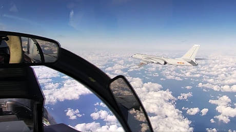 In this photo taken from a video distributed by Russian Defense Ministry Press Service, on Tuesday, Dec. 22, 2020, a Chinese H-6K strategic bomber flies during a joint patrol mission over the Western Pacific. © Russian Defense Ministry Press Service via AP