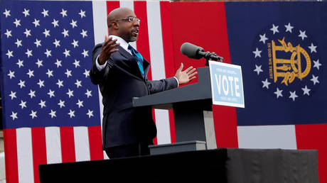 Georgia Senate candidate Raphael Warnock is shown campaigning in Atlanta earlier this month.