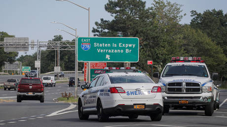 New York City Sheriffs work at a Covid-19 checkpoint to randomly stop drivers entering the city, in Staten Island, New York, US