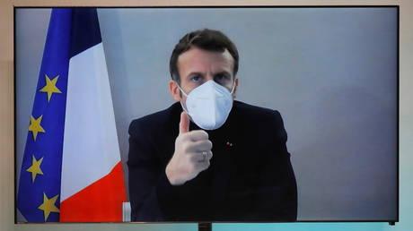 Emmanuel Macron participates in an event via video link in Paris, December 17, 2020.