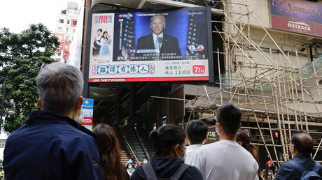 FILE PHOTO: A news report of Democratic 2020 U.S. presidential nominee Joe Biden is seen on a television screen in Hong Kong, China November 8, 2020