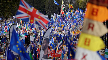"""FILE PHOTO Anti-Brexit remain in the European Union supporters take part in a """"People's Vote"""" protest march calling for another referendum on Britain's EU membership © AP Photo/Matt Dunham"""