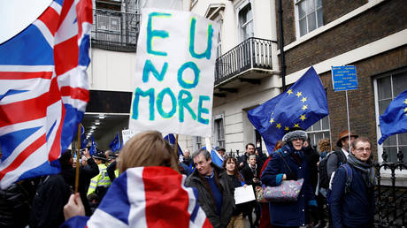 FILE PHOTO: Pro-Brexit supporters celebrate Britain leaving the EU on Brexit day as anti-Brexit demonstrators are seen walking in the opposite way in London, Britain January 31, 2020