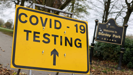FILE PHOTO: A sign is seen at a coronavirus test centre at Stanley Park, near Anfield, Liverpool, Britain, November 5, 2020 © Reuters / Carl Recine