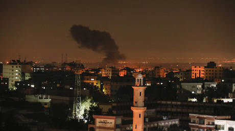 Smoke and flames are seen following an Israeli air strike in Gaza city, on December 26, 2020