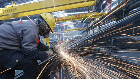 FILE PHOTO:  Employees process steel products at a factory of Huazhao Dongnan (Yuncheng) Green Building Integration Co., Ltd on December 16, 2020 in Yuncheng, Shanxi Province of China.