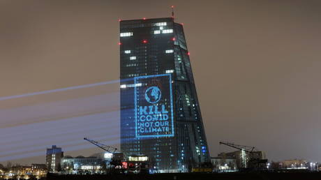 FILE PHOTO: Activists project a slogan against the facade of the European central bank (ECB) headquarters in Frankfurt, Germany, on December 9, 2020.