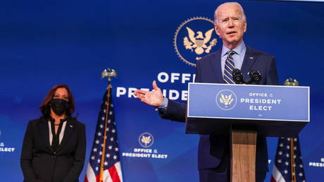 Joe Biden and Kamala Harris speak after a foreign policy briefing at his headquarters in Wilmington, Delaware, December 28, 2020.