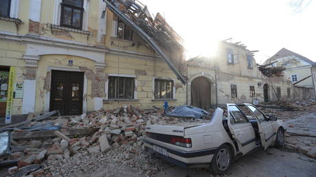 Destroyed houses and a car are seen on a street after an earthquake in Petrinja, Croatia December 29, 2020.