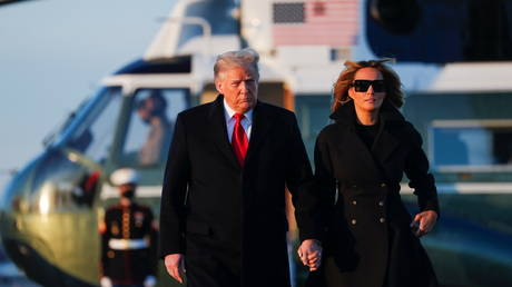 President Donald Trump and first lady Melania Trump prepare to board Air Force One, December 23, 2020.