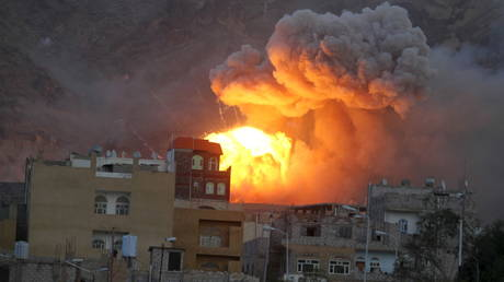 FILE PHOTO: Fire and smoke billow from an army weapons depot after it was hit by a Saudi air strike in Yemen's capital, Sanaa.