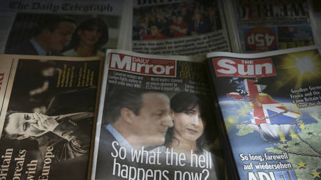 FILE PHOTO: Newspapers are displayed for sale in central London