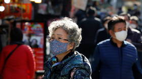 Seoul tightens Covid-19 restrictions to second-highest level amid spike in infections