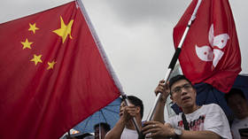 Hong Kong activist found guilty of desecrating Chinese flag after becoming 'first person arrested' under new security law
