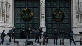 GUNMAN opens fire outside St. John the Divine church in Manhattan after Christmas choir performance