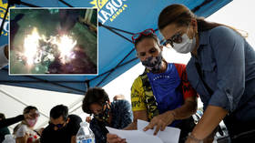 Venezuela's Guaido-led opposition holds alternative vote and then BURNS BALLOTS after boycotting legislative elections