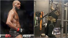UFC star Jon Jones works out in camo gear with GUN strapped to his chest as Dana White says former champ is 'ready' for return