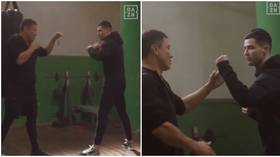 'He looks like a real fighter!': Boxing ace Gennady Golovkin puts Cristiano Ronaldo through his paces in the training room (VIDEO)