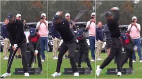Tiger cub: Golf world stunned as Tiger Woods' 11-year-old son Charlie shows off IDENTICAL swing to his father (VIDEO)
