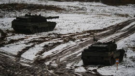 As Belarus shuts border, Lithuania invites NATO for war games with tanks & troops just 8km from shared frontier