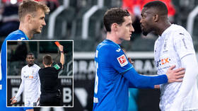 'He should be SACKED': Fan fury after football ace cops ban for spitting in opponent's face amid COVID-19 surge in Germany (VIDEO)