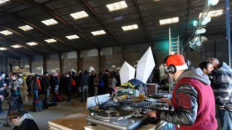 A DJ is pictured as the Lieuron rave continues on January 1, 2020.