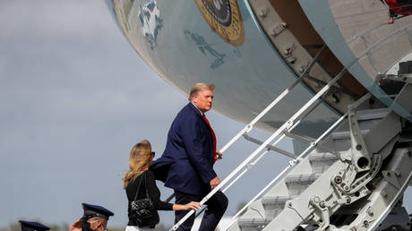 FILE PHOTO: U.S. President Donald Trump boards Air Force One with first lady Melania Trump at Palm Beach International Airport in Florida, US, December 31, 2020