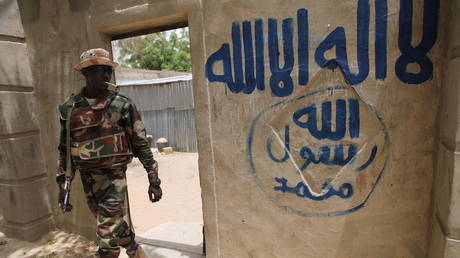 FILE PHOTO: A Nigerien soldier walks out of a house that residents say a Boko Haram militant had forcefully seized and occupied in Damasak, March 24, 2015 © Reuters / Joe Penney