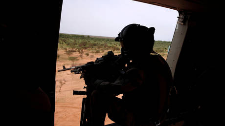 FILE PHOTO. A French soldier mans a machine gun in the door of a NH 90 Caiman military during Operation Barkhane in Mali.